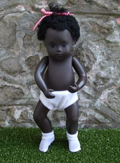 She is in good used condition. I think she is adorable and slightly different to the usual black Sasha baby. She will come dressed as shown in her original knickers with a nylon rosebud print dress from the 1960's. | eBay!