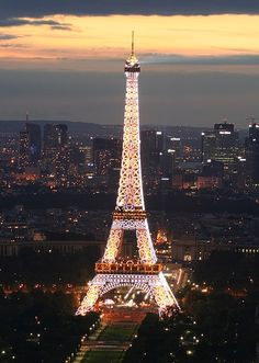 You know, I never really liked the Eiffel Tower. It never seemed romantic or something that I would want to see but the pictures taken at night with the lights on make it look very pretty :)