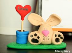 Love Grows Bunny mini clay figurine by BunnyDiary on Etsy, $22.00