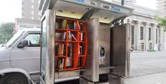 Guerrilla Library out of a payphone booth... this is even better than guerrilla urban knitting.