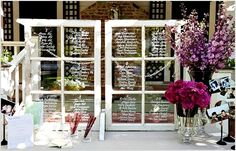 Window frames painted black or pink with menu, seating chart, or the like on each pane.