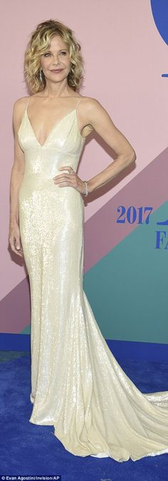 Star power:Meg Ryan, 55, looked breathtaking in a fitted white sequin gown by Christian S...