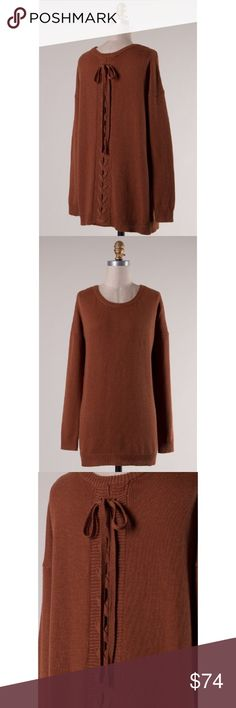 🍂COMING SOON Rust Lace Up Sweater - Fall 2016 Dropped shoulder, long sleeve, round neck, crisscross with self-tying strap on back, solid sweater. 65% Acrylic 25% Wool 10% Polyester Sweaters Crew & Scoop Necks