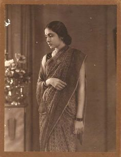 The beautiful woman seen here is Sharda Pandit, a scion of a Maharashtrian aristocratic family in the earlier half of the 20th century. She was born in Rajkot, Gujarat. She was hailed as the 'Beauty Queen' of Elphinstone College of Bombay, later became the Governor of two Indian States. Circa 1935