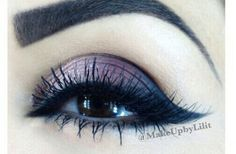 Purple eye makeup that looks stunning with various eye colors! Use scotch tape under the eye, and you can have a perfect wing when you peel it away!