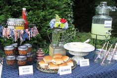 Backyard BBQ Bash - LOVE the baked beans in mini canning jars, and the Build-Your-Own Shortcake Bar, cute paper cone chip holders, too!