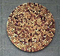 This abstract wall piece is a mosaic of wine-bottle corks. PHOTO BY: Deirdre Hamill/The Arizona Republic