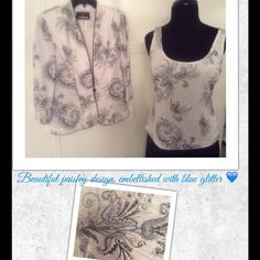 Designer Shell & Jacket Beautiful, 2-piece garment for your special occasion. Includes shell and matching jacket, with paisley design, embellished with blue glitter. Colors are white & black. Jacket has black satin trim, 3/4-length sleeves, and a black button for fastening. Tops