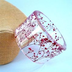 Resin Bangle with Real Pressed Red Bay's Breath. This shop has so many lovely pieces, all made with real flowers!
