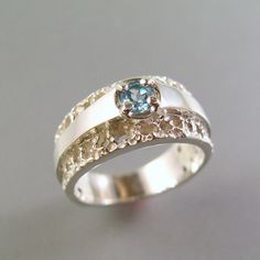 I completely adore this ring. I'd want either a dark sapphire or yellow diamond stone, I think.