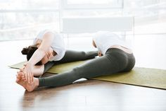 Two women stretching legs on green yoga mat by vadymvdrobot. Two pretty young women stretching legs on green yoga mat Line Illustration, Illustrations, Partner Yoga, Best Yoga, Asana, Photography Props, Exercise, Poses, Legs