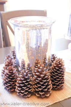 Arrange some fallen pine cones around a mirrored vase to add to your holiday tablescape this season!