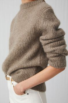 The broad-gauge half-cardigan rib is a traditional knit used for fisherman's jumpers. In this version, it is knitted from a woolly blend of alpaca, cashmere and mohair with nylon added for a lighter weight and extra strength, resulting in a soft and regular-fit jumper with a chunky crew-neck collar. Two rows of Lycra® added to bottom and cuff ribs for better shape Elastic tape in shoulder seams to keep shape Knitwear > Crew neck