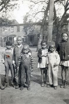 Vintage African American photo of children posing for the camera.