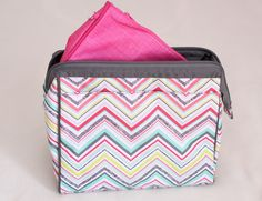 Party Punch Thirty One Cosmetic Bag Set $35. in six patterns  or host a party and get  this and a flat iron holder for $20.