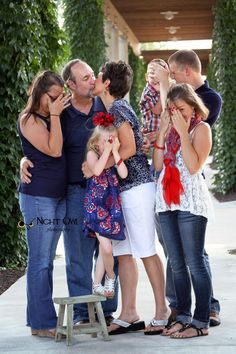 I'm not sure what's going on here... Looks like two sets of adults, and the one guy is kissing the woman but has his arm around the other woman's waist.. Wtf? @Heather Hautamaki
