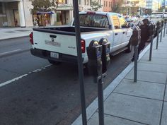 """DC City employees taking a 30 minute smoke break downtown during morning  rush hour, blocking eight motorcycle parking spots. Tried to report via the broken meter number, but there wasn't a """"blocked by assholes"""" option in the automated call menu."""