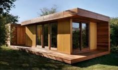 This modern prefab cabin, called the BlueSky MOD, is one of a few examples of affordable green modular homes currently available today (see these books for more examples). It was designed by Todd Saunders, an… Modular Cabins, Prefab Cabins, Prefab Homes, Modular Homes, Tiny Homes, Modern Cabins, Mini Loft, Park Model Homes, H & M Home