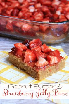 Homemade Peanut Butter and Strawberry Jelly Bars - Magical peanut butter bars topped with strawberry preserves and fresh strawberries make a great lunchbox treat or after school snack!