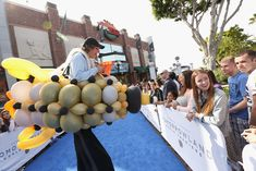 <p> A stilt walker outfitted in a balloon spaceship greeted fans at the world premiere of Disney's <em>Tomorrowland</em>, which took...