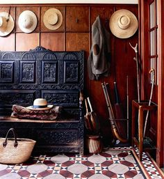 entry, wood walls, tile floor. handcarved sitting bench
