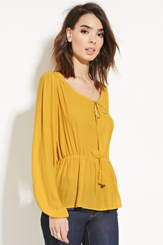 Forever 21 Contemporary - A woven chiffon peasant top featuring a tasseled self-tie split neckline, button-cuff long sleeves, an elasticized waist, and shirred detailing along the yoke.