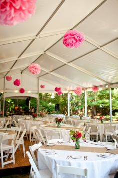 Tissue paper party pom poms to decorate the marquee - cheap + high impact!