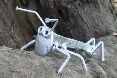 welding+nuts+to+steel+pipe+on+sand+rails | Welded Grass hopper from rail road spike and nails