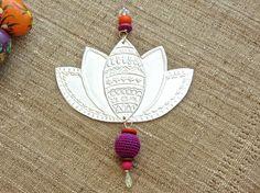 Pretty chotchke https://www.etsy.com/listing/184369027/lotus-flower-hanging-decoration-gypsy