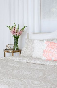 Obsessed with the new home collection from Cupcakes and Cashmere! These lace-print grey pillow shams are made with pure cotton and are so beautiful and chic. Love the entire bedding set and how it matches with the gold bedside table.