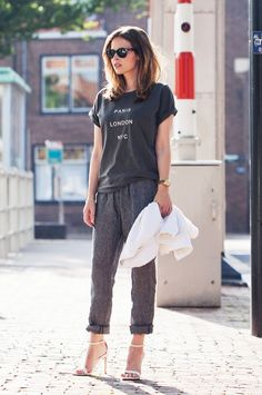 Christine Reehorst of Fash-N-Chips wearing a graphic statement tee and loose pants with strappy heels