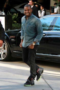 Kanye West in Air Yeezy 2's topped w/ a Denim Button Up. Simply dope