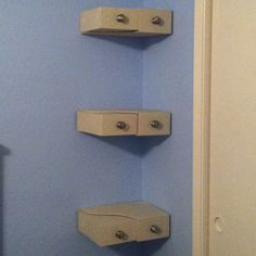 Ikea wooden magazine holders + spray paint + knobs = DIY storage shelves