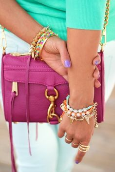 This ties in all the popular fashion trends for spring: color blocking, bracelet layering, and spiked wrist bands