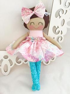 This is a Cloth Doll that is part of the Dressy Doll collection from Sew Many Pretties. This 14 inch handmade doll is made from 100% cotton fabrics and wool blend felt for her hair. Facial features are hand embroidered. Her hair bow and lace headband are sewn securely. She wears a ruffled, cotton skirt with a velcro closure in the back. You have the option of adding on a tulle underskirt for extra fanciness to her look. The underskirt has an elastic waistband that makes it easy for young…