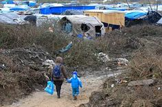 A migrant and her child in the southern part of the camp of migrants in Calais, in February 2016