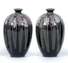 Pair of black & grey Japanese Cloisonne vases. Meiji Period. (c.1900) Bulbous shape with intricate silver wire pattern of hanging wisteria flowers & vines on black background.