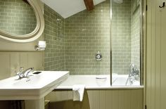 Gorgeous sage green crackle glaze metro bathroom wall tiles at a small boutique hotel. From our Harlo range.