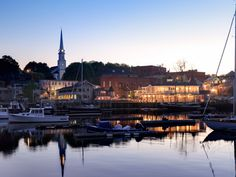 "Camden, Maine - This classic New England seaside town is so picture-perfect that it was the primary filming location for the 1957 movie about a seemingly idyllic town, Peyton Place. The motto of Camden has long been ""Where the mountains meet the sea."" (Indeed, Mount Battie and Bald Mountain rise up above the harbor & the village, & a hike to the top of the former will reward you with a stellar view.)"