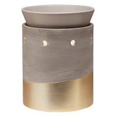 Perfect with salvaged wood and exposed steel, or soft linens and your grandmother's antique armoire. Cement-finish stoneware, dipped in metallic-gold glaze.
