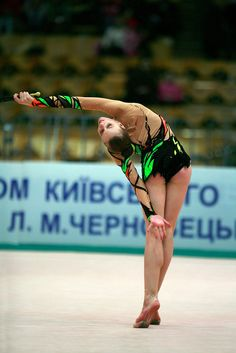 Valeria Shurkhal of Ukraine body waves with clubs at 2008 World Cup Kiev