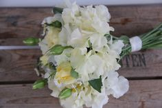 soft yellow bouquet of roses and sweet peas