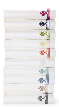 Not-so-basic white sheets make a great foundation for layering color and pattern throughout the room–think of them as classics with a twist. Thanks to 300-thread-count pure-cotton sateen, they're also wonderfully comfortable. What is the pattern? An ancient Buddhist motif, representing the endless knot of wisdom, is embroidered in a fun color on the flat sheet and cases.