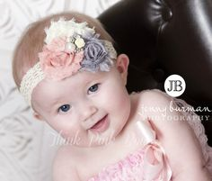 So Adorable!!!! This vintage couture inspired headband features three frayed shabby chic flowers in vintaage pink,grey and Ivory on a soflt a delicate lace headband. The center flowers is topped with a precious jeweled center to complete a amazing look . The flowers are felt backed for comfort. Simple and yet elegant, sure to be a real head turner!! Pair it with one of our adorable lace petti rompers for a complete look.Headband as pictured in Vintage Pink Ivory and Grey