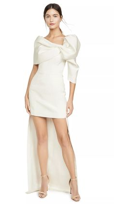 Bridal mini dresses are a statement-making trend that's here to stay. So we've researched the best short wedding dresses for the modern bride.  Hellessy Short Dress with Train