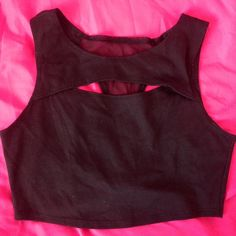 Black crop top All black crop top, a cut out in the front, black see through material on the back, has been worn, good condition Body Central Tops Crop Tops