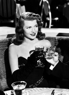 Rita Hayworth in 'Gilda'. That dress. That attitude. Maybe not the smoking though.