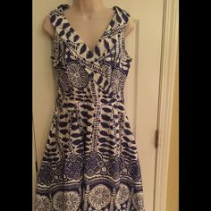 Jessica royal blue and white sleeveless dress Charming little dress is perfect for any special occasion. Features a shawl collar neckline, side zipper, and pleated fully-lined, A-line skirt. There are belt loops so you can accent your waist with a belt or sash. 97% cotton/3% spandex. Jessica Dresses