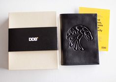 Hand made leather passport holders with a First Nation design symbolizing creativity was embossed on the front and client's logo embossed on the back. Custom designed box sleeves and insert cards shared the symbolism of the design as well as DDB ad agency's personal note of gratitude details appreciated by client and recipients.