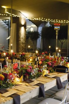 Love this wedding reception! The lush florals, the natural wood, and the tapers are perfect.